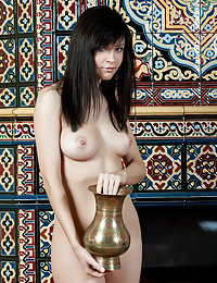 Dark-haired seductress with bangs showing off her lustful holes