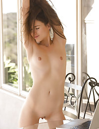 Absolutely stunning brunette with a winning smile gets naked