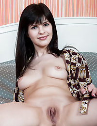 Dark-haired seductress spreading her legs in a cheap hotel room