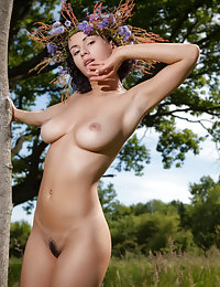 White dress wearing forest nympho revealing her hairy pussy outdoors