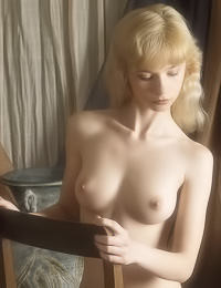 Elegant blonde viixen Jane A poses fully naked on the chair and shows her smoking body.