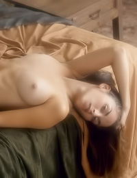 Beautiful Alissa A poses nude on the bed and gently touches her dripping wet meat hole.