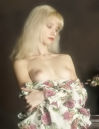Passionate blonde angel Jane A takes her white dress slowly and reveals her fantastic rack.