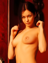 Classy brunette gal Tanya F takes her see through sexyd ress off and shows us her cleveage.