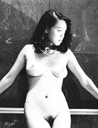 Black and white photo session of hot naked lady with hairy pussy is pleasure for eyes.