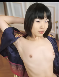 Minako B: Foxy Asian babe Minako B takes her tight blue jeans and white thongs off in her apartment.