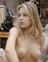 Busty blonde babe Inna A poses in the museum completely naked and shows her giant melons.