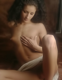 Passionate model Erika D slowly strips her vintage cltohes and then plays with her tatas.