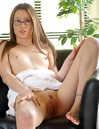 Cute looking teen babe Jassie A takes her white dress off and plays with her trimmed cunt.