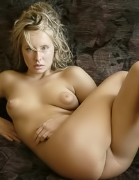Big breasted blonde chick Koika poses naked on the sofa and plays with her huge nipples.