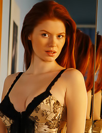 Tanya I is a redhead girl with fantastic body and a brand new corset and stockings to show.