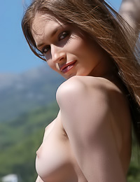 Great wilderness always gets long haired brunette to get out of all of her clothes and pose.