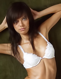 Attractive brunette vixen Iren C teases us with her foxy body in white thongs and matching bra.