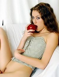 Classy teen honey Jassie A eatas an apple and slowly strips her sexy corset to show her ass.
