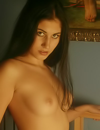 Big breasted brunette gal Gaby B takes off her gown and shows her beautiful big breasts.