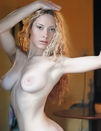 Curly hairred blonde babe Maria G undresses by her window and shows her body to the neighborurs.