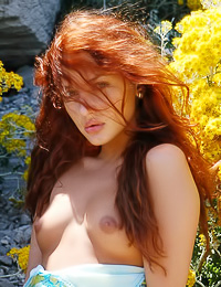 Redhead girl with long hair and fine body lets her summer dress fall down to reveal hot body.