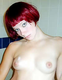 Beautiful redhead model Jackie A takes her white shirt in the shower as she exposes her body.