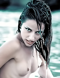 Foxy brunette lady Liliana takes off her dress in the river and shows her perky small tits.