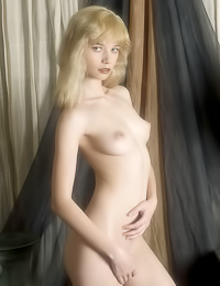 Pale blond gal with slim figure takes on a role of an erotic model, showing her sexy figure.
