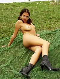 Hot fresh brunette decided to take her clothes off in the field and to enjoy posing naked.