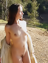 Outdoor nudity is what this brunette girl likes the most, she gets all perky and moist.