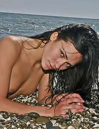 Small breasted brunette vixen Sasha C takes her bikini off on the beach and shows her cunny.