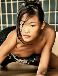 Lusty Asian babe Pui poses in slutty black thongs and really bitchy high black boots.