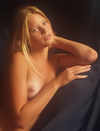 Beautiful and sexy blonde gal Andrea C takes her clothes off and shows us her hot body.