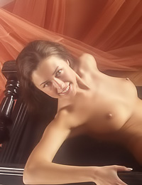 Corinna B: Classy brunette lady Corinna B poses on her piano nude and teases with her hot curvy body.