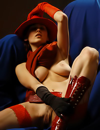 Elena G: Redhead chick Elena G looks absoulutely stunning in these kinky, slutty outfits and lingerie.