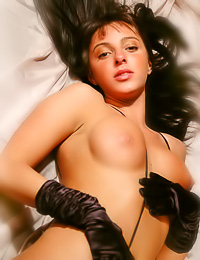Lusty Ester A takes her expensive black lingerie off and shows her magnificent big breasts.