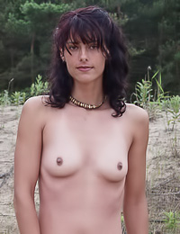 Megan A wants to relax a bit on the beach and the best way to do it is when she is naked.