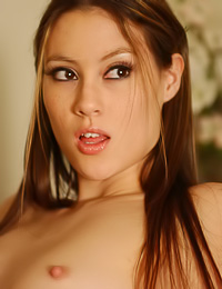 Beautiful and sexy teen gal Jassie A takes her clothes off on the sofa and shows her boobs.