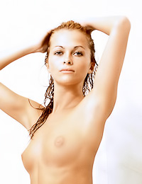Lovely blonde gal Barbara A lets us watch her as she takes a hot shower in front of the camera.