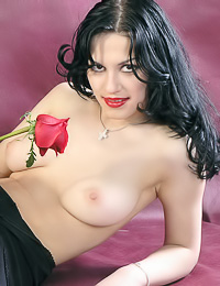 Seductive big breasted Irina C poses in her slutty night dress and romantic red rose.