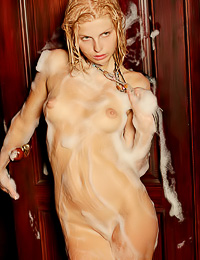 Lovely blonde cuttie Nastya C takes a hot bubly shower wearing her sexy see through shirt.