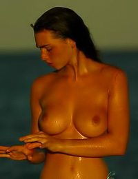 Chloe A: Busty brunette hottie Chloe A takes her bikini off by the ocean and shows us her big jugs.