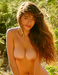 Beautiful and sexy model Larissa A strips her clothes outdoors and shows us her big juicy boobs.