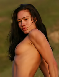 Smoking hot brunette chick Sasha C poses nude outdoors and teases with her hot bouncy ass.