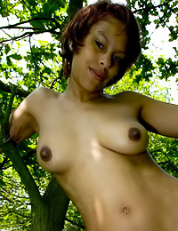 Busty Inke A takes off her sexy black corset in the woods and shows us her massive boobs.