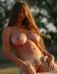 Big breasted country girl Aneli A walks near the hay nude and shows us her huge jugs.