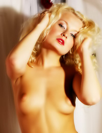 Lusty blonde vixen Katka A strips slowly and shows us her incredibly hot round breasts.