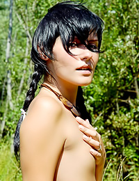 Brunette babe Anna R enjoys posing nude in the woods and shows us her fuckable, shaved fanny.