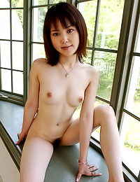 Cute faced Asian babe took her clothes off as well as her panties and took some naked photos.