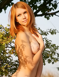Cute redhead girl with perky boobs and seductive smile posing in hot MetArt photo gallery.