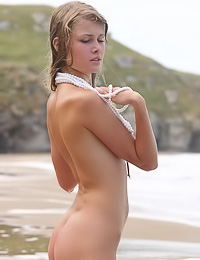 Small breasted blonde hottie Nastya A takes her bikini off on the beach and shows her round ass.