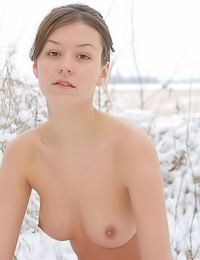 Despite snow and cold Rita A decided to strip fully naked outdoors and show her perky boobs.