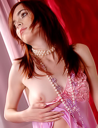 Beautiful and attractive redhead bimbo Masha F takes her pink slip off and shows her wet cunny.