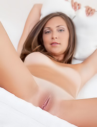 Sophia E: Sophia E takes all of her lingerie before the camera and fingers her deep shaved muff.